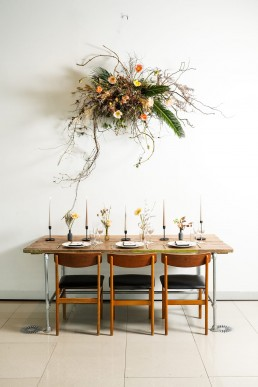 stripped table and flower bomb