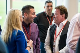 Delegates laugh over a coffee at ActionCoach's Franchising event in Burton on Trent