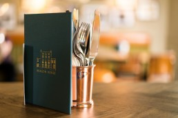 cutlery and menu with creamy bokeh