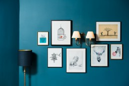 blue wall with pictures