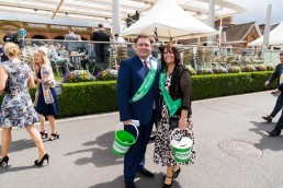 2 volunteers collecting money at York Races for Macmillan